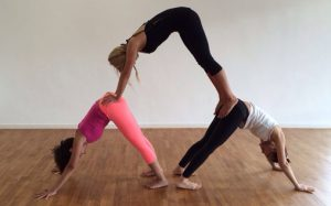 3 Playful Yoga Poses To Practice With A Partner